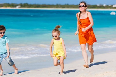 kids-on-vacation-running-on-beach-in-jamaica