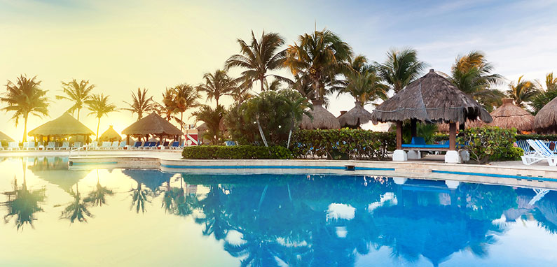 caribbean-poolside-hotel-at-sunrise-795x382