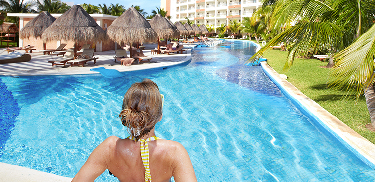 caribbean-vacation-woman-in-resort-pool